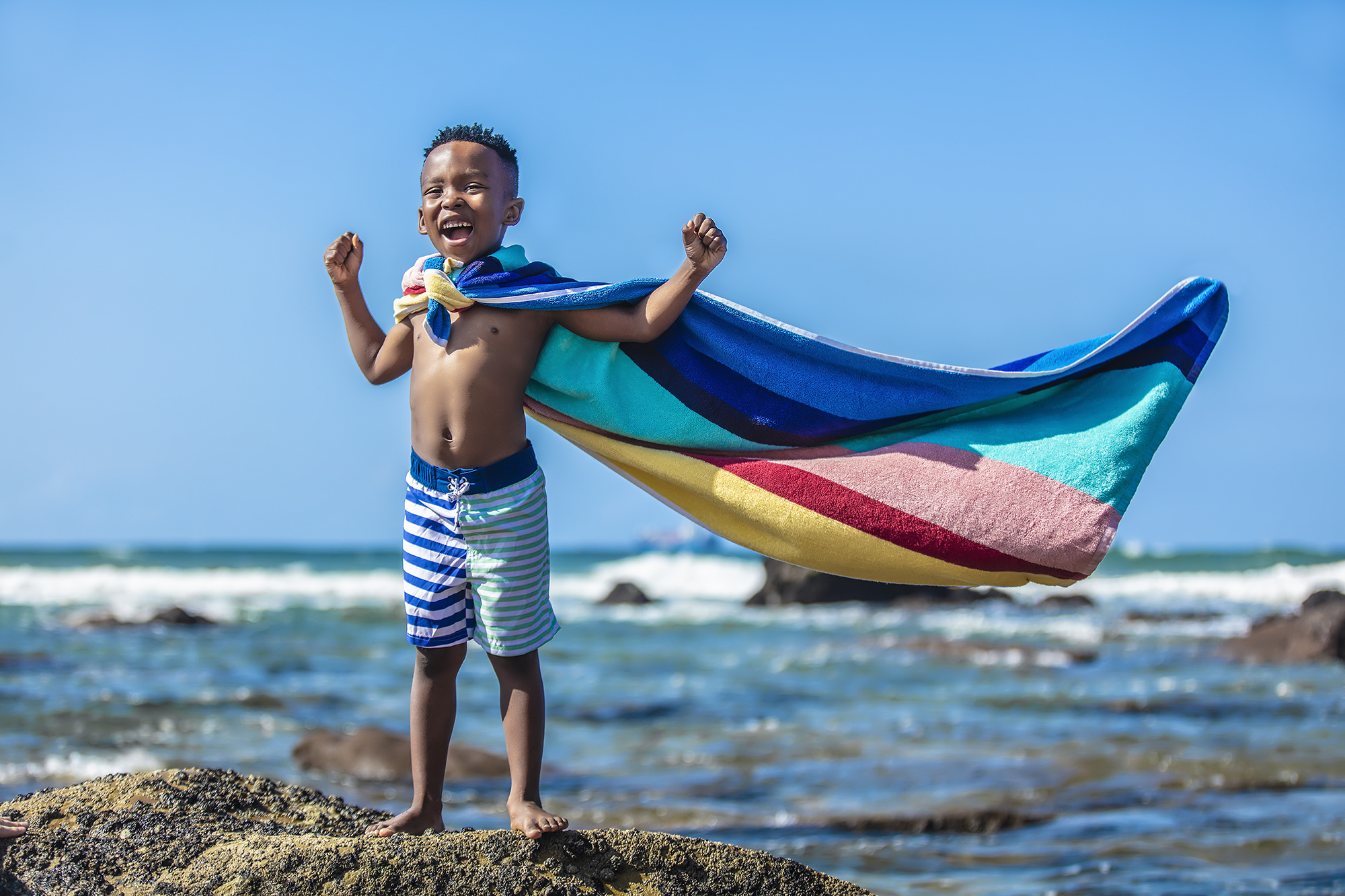 Image of boy on rock at the beach at the Beverly Hills Hotel in uMhlanga Rocks, Durban for  Tsogo Sun's Image Library & Content Library by Michelle Wastie Photography