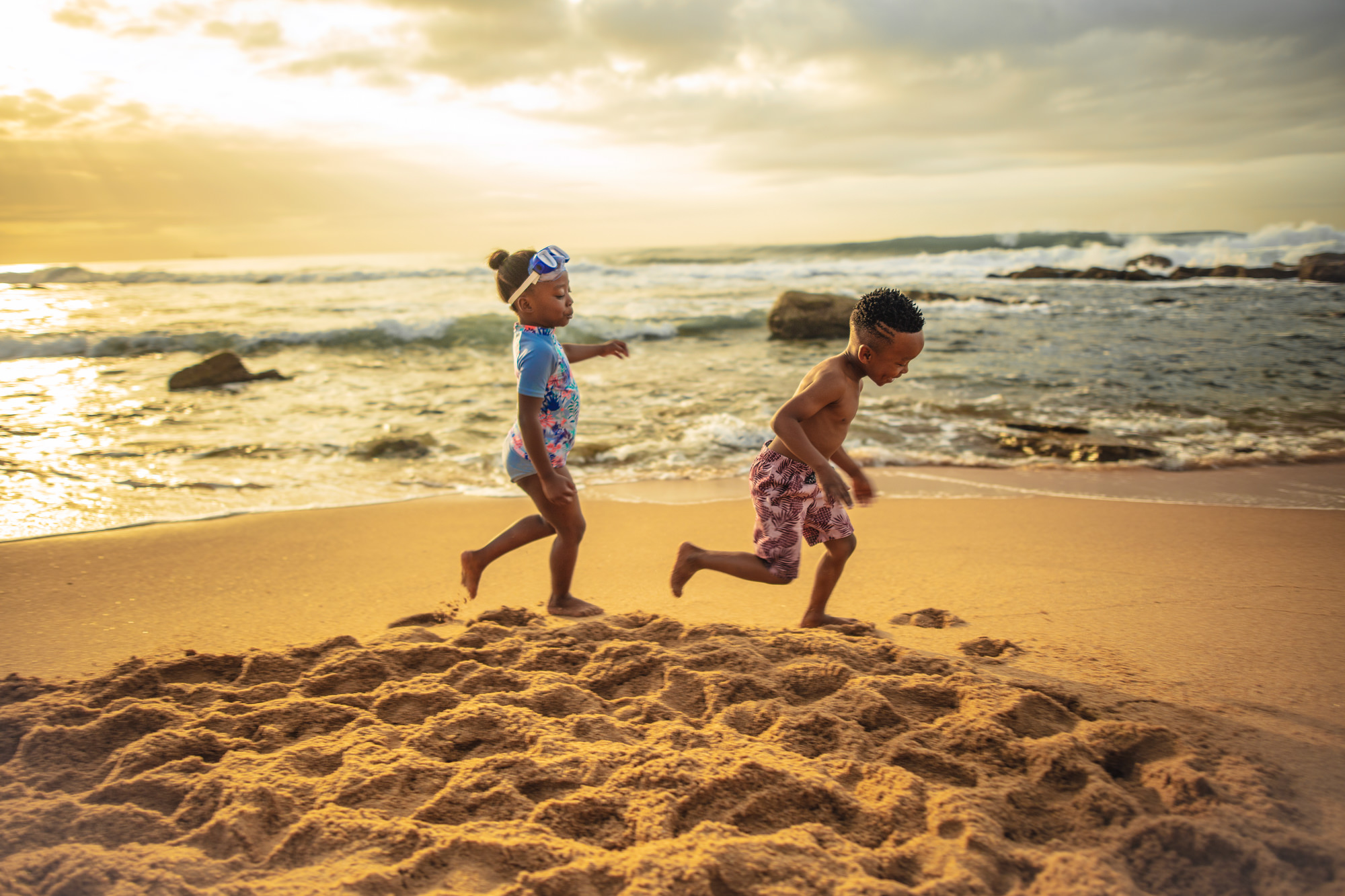 Image of children having funon the beach for Tsogo Sun's Image Library & Content Library by Michelle Wastie Photography