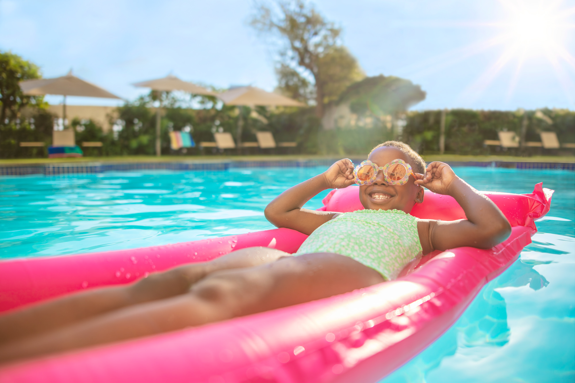 Image of girl in a pool for Tsogo Sun's Image Library & Content Library by Michelle Wastie Photography