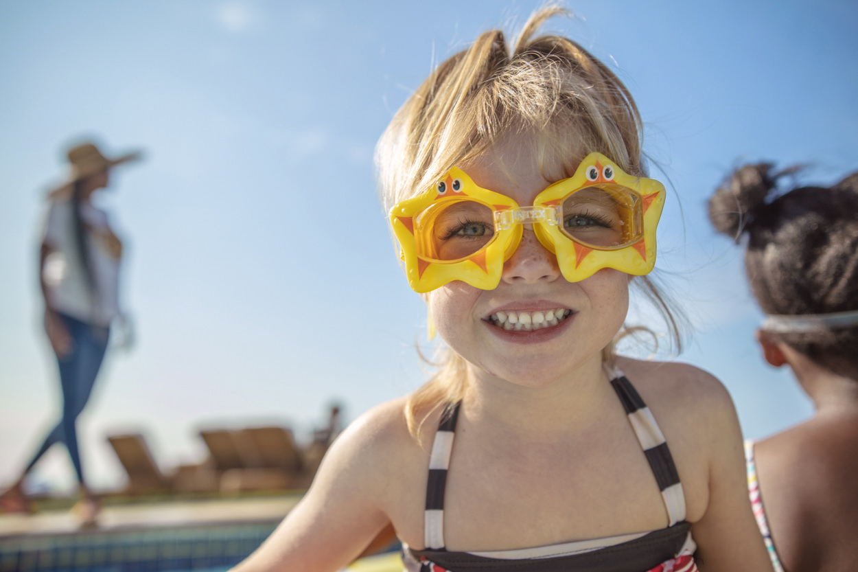 Image of girl having fun in the pool for Tsogo Sun's Image Library & Content Library by Michelle Wastie Photography