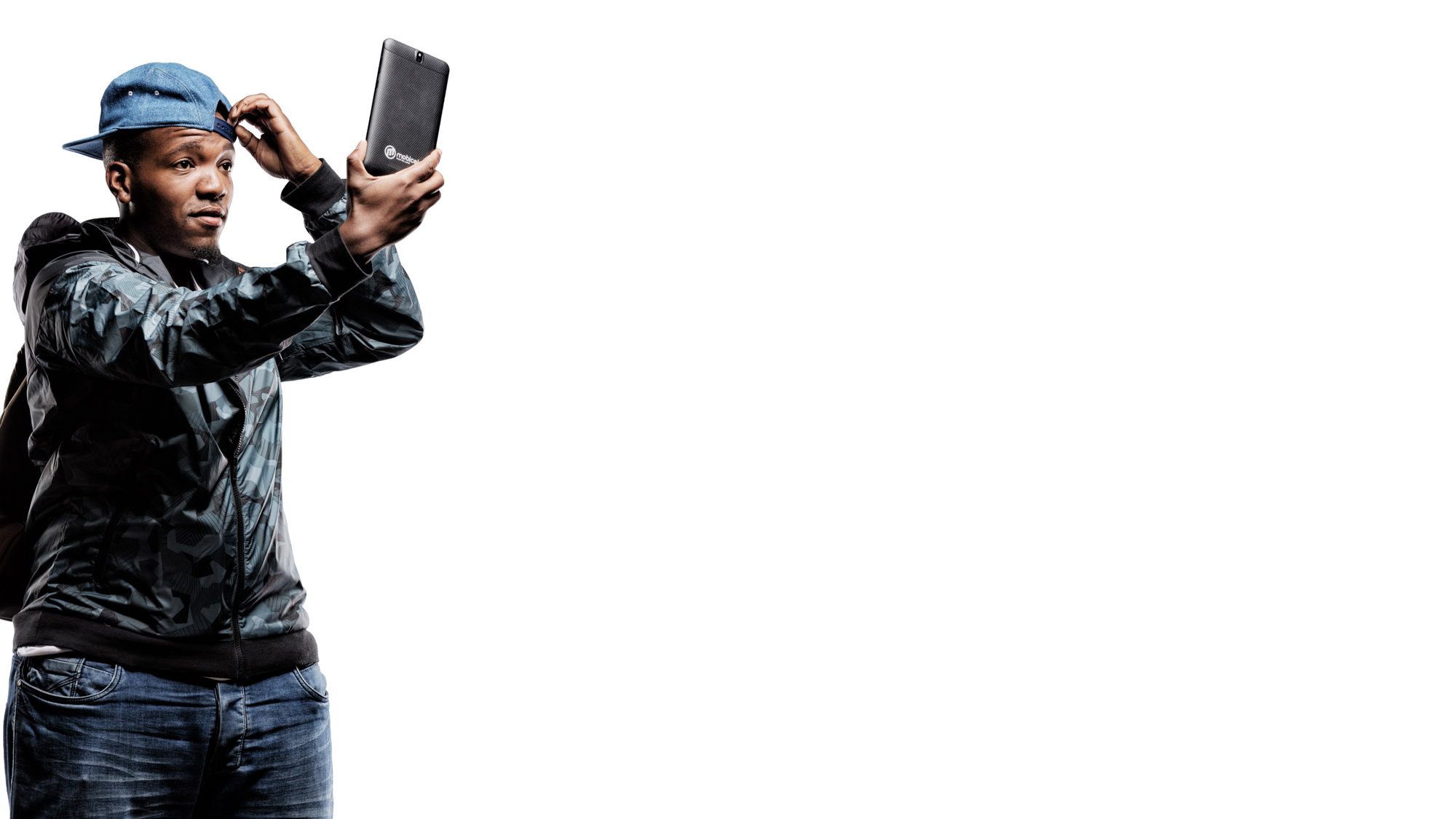 Kingsley Palime holding a Mobicel mobile phone for the Mobicel Going Places Commercial which was directed by Michelle Wastie Photography