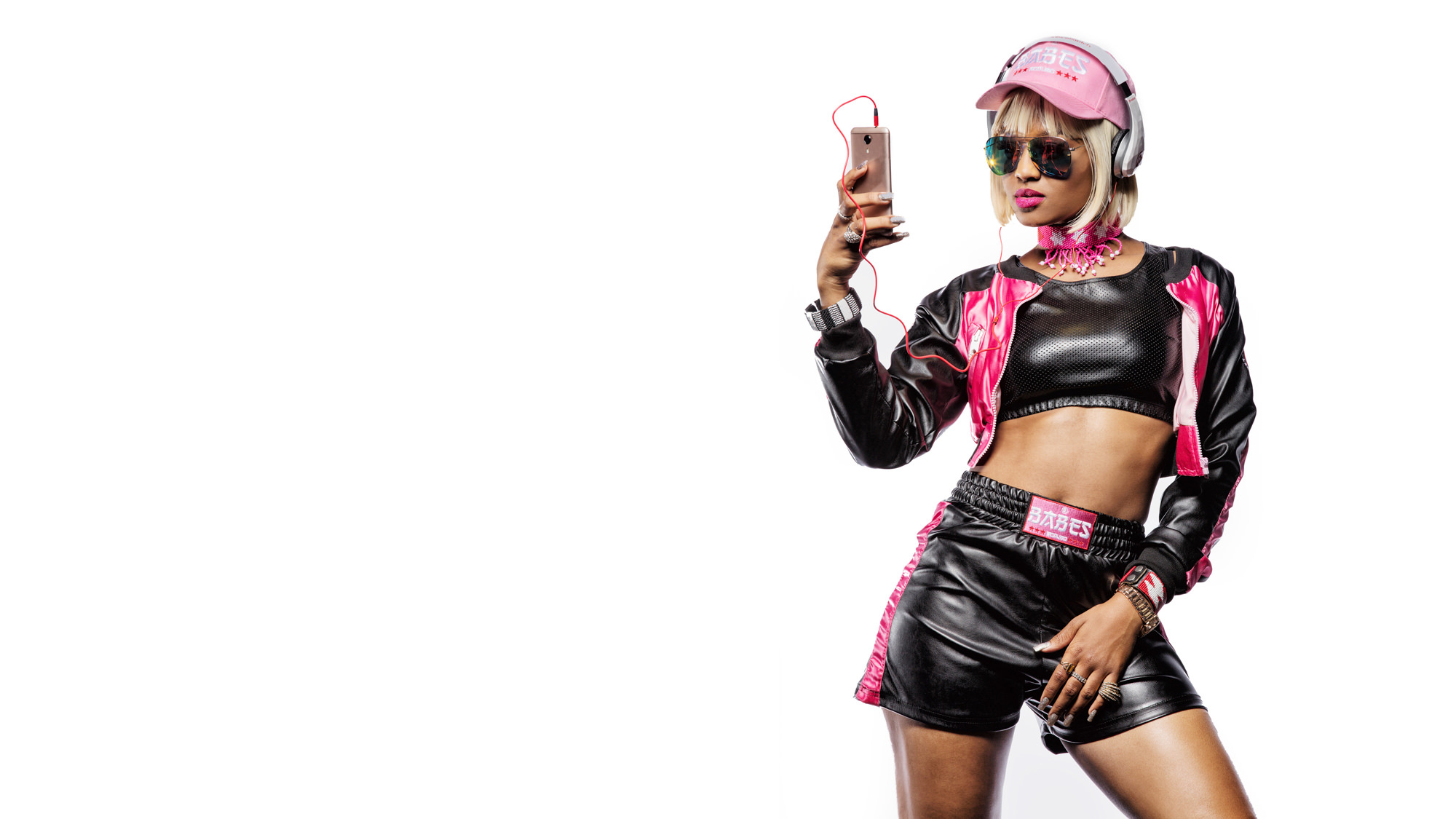 Babes Wodumo holding a Mobicel mobile phone for the Mobicel Going Places Commercial which was directed by Michelle Wastie Photography