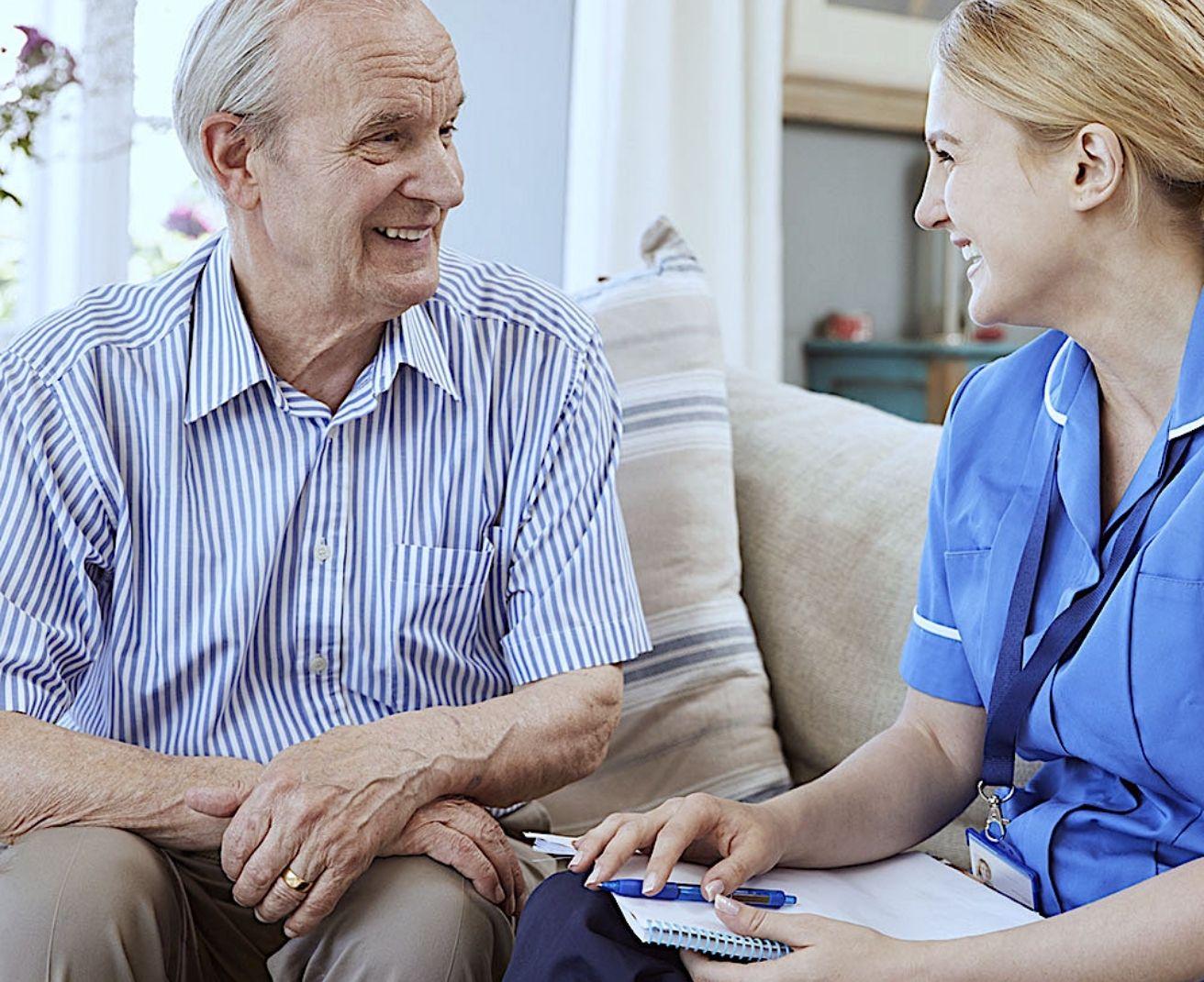 Elderly male patient with nurse