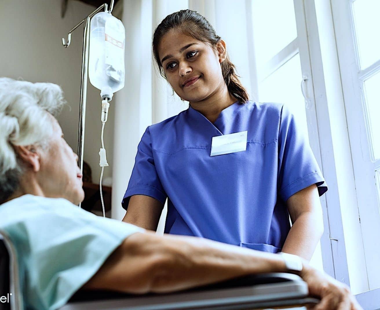 Elderly patient in wheelchair with nurse