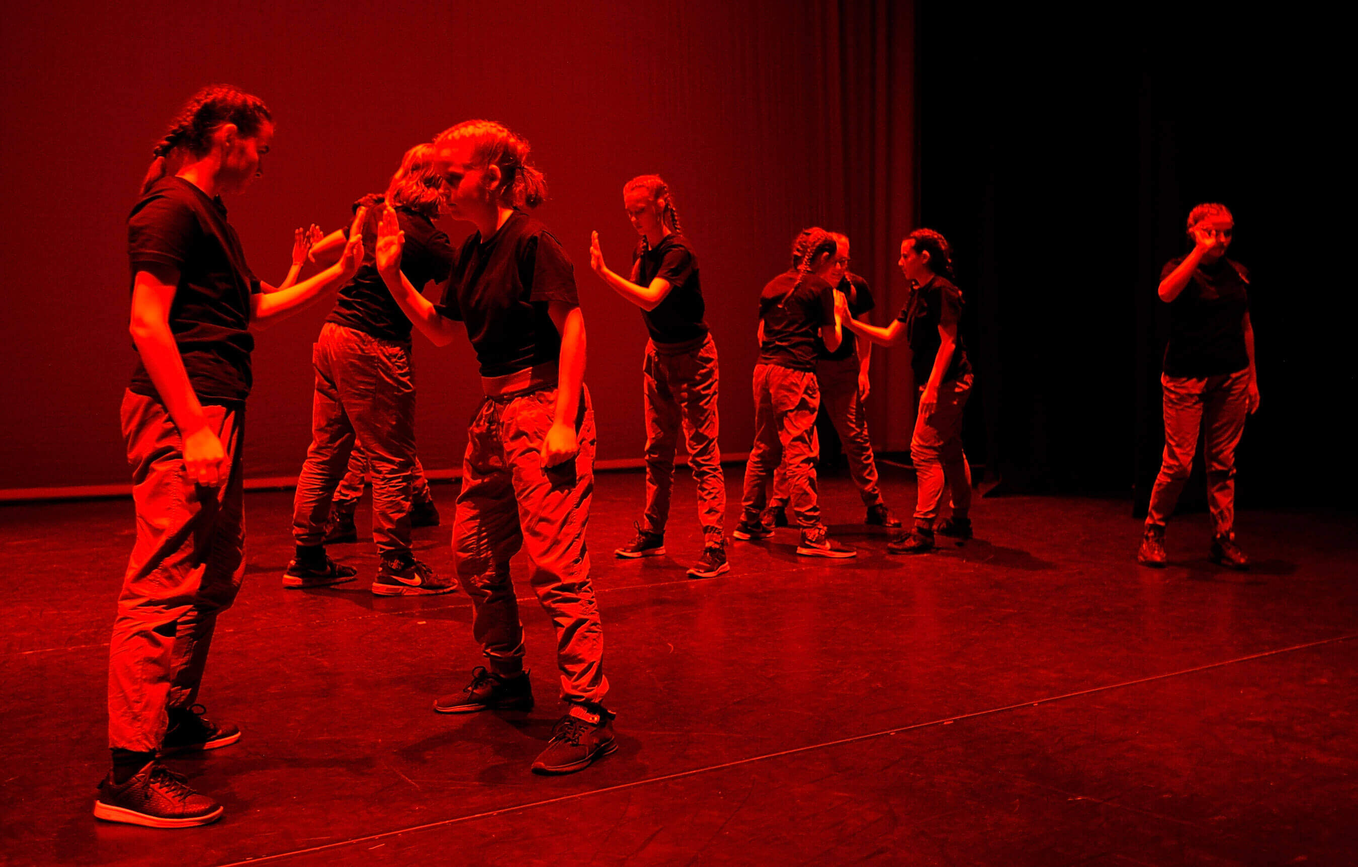 Young teens on stage performing street dance