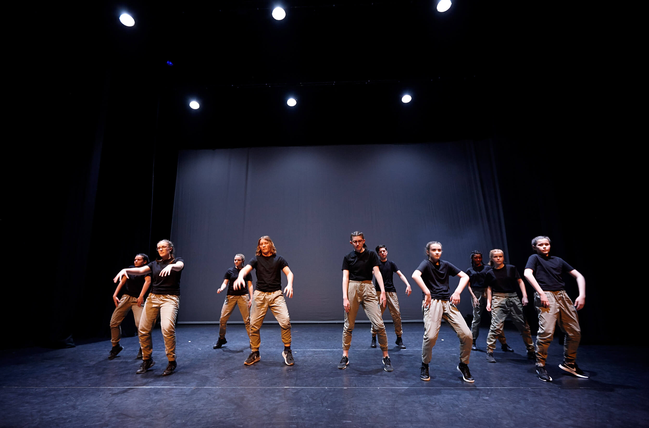 Young teens performing Hip Hop Dance onstage