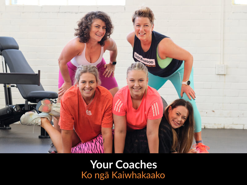 5 gym trainers kneeling and standing