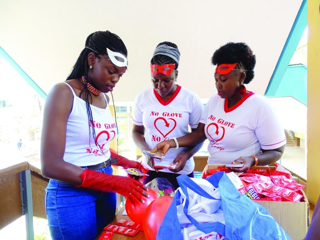 3 ladies preparing for community trainings on women's health and empowerment