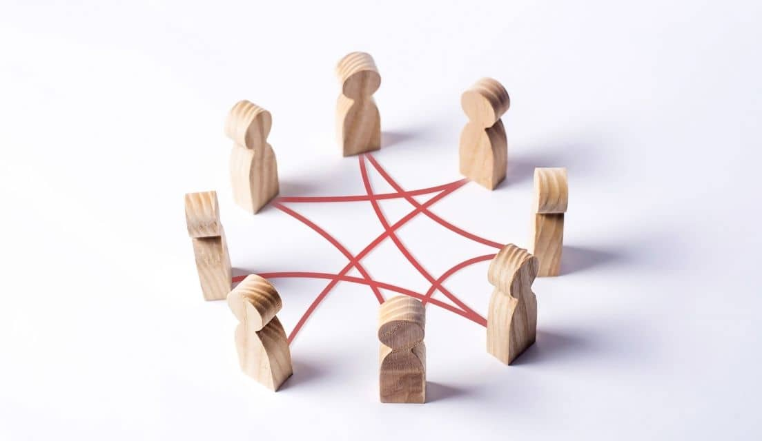 Little wooden 'people' figurines placed standing in a circle
