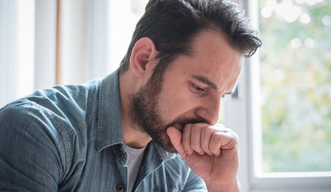 Man thinking pensively and leaning on his fist