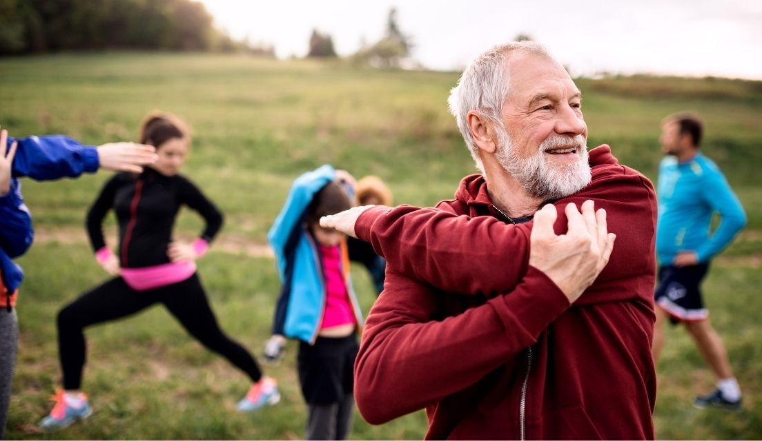 Senior man stretching before a run