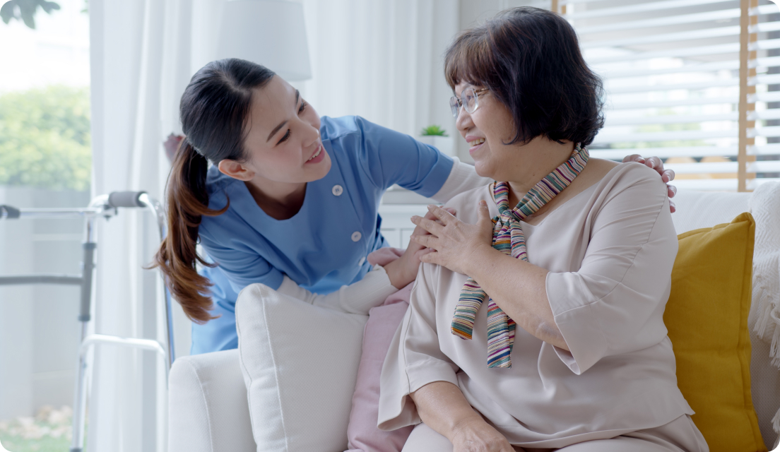 Senior asian woman getting assistance in a senior home