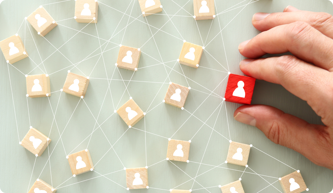 Red wooden block being connected to other wooden blocks in a network