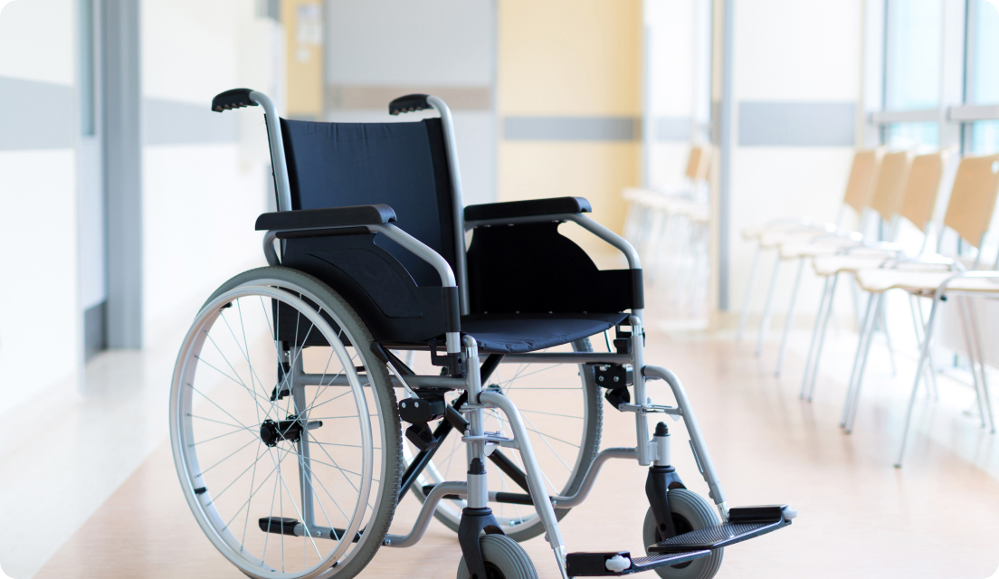 Empty wheelchair in empty hallway