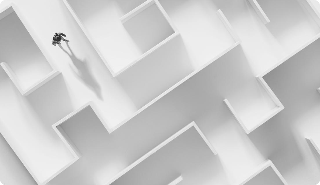 Man entering white maze