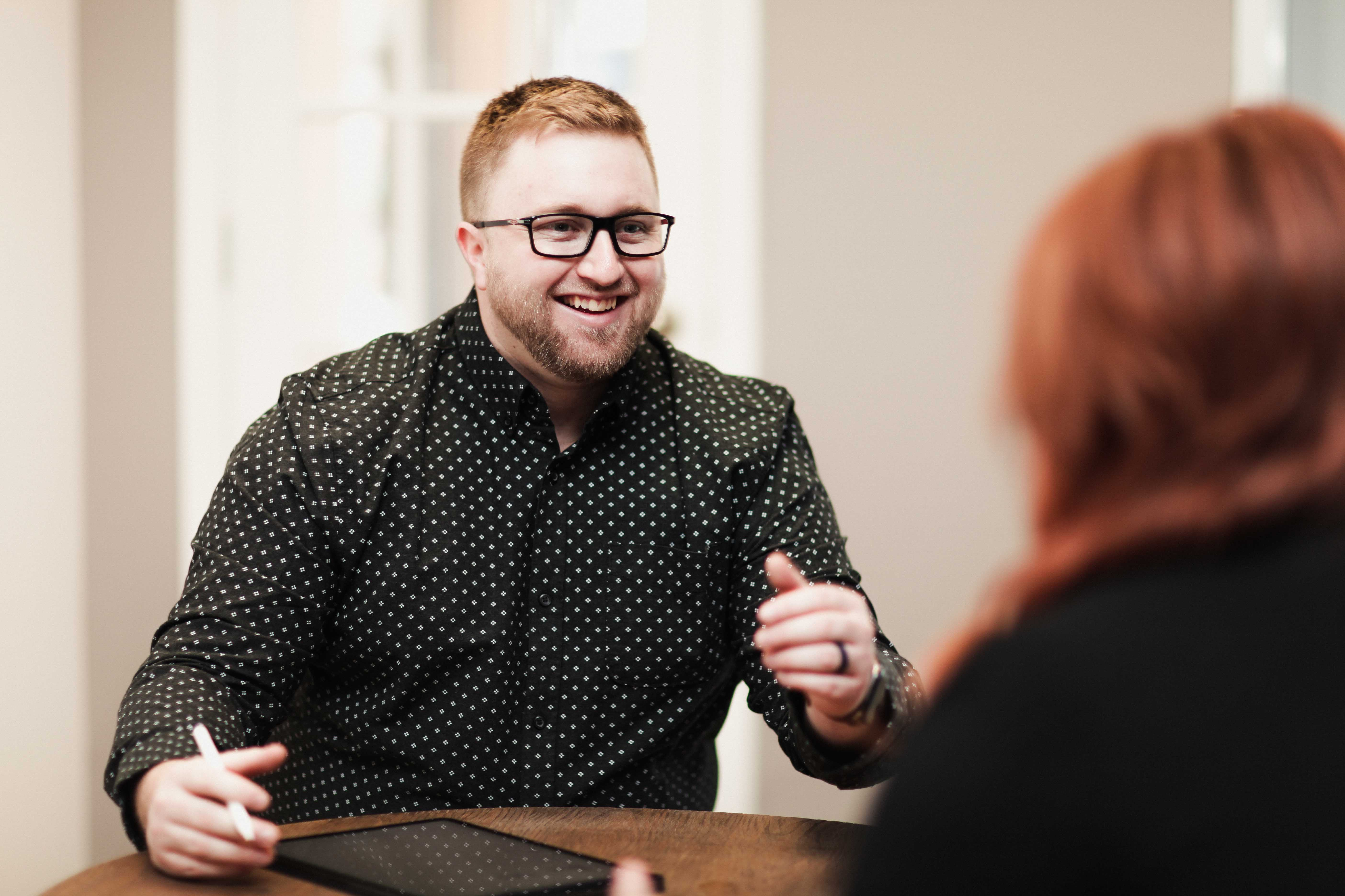 Photo of Brad talking to a client