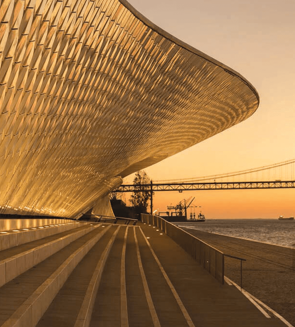 Portugal MAAT Museum Photo at Sunset with 25 de Abril Bridge in the back