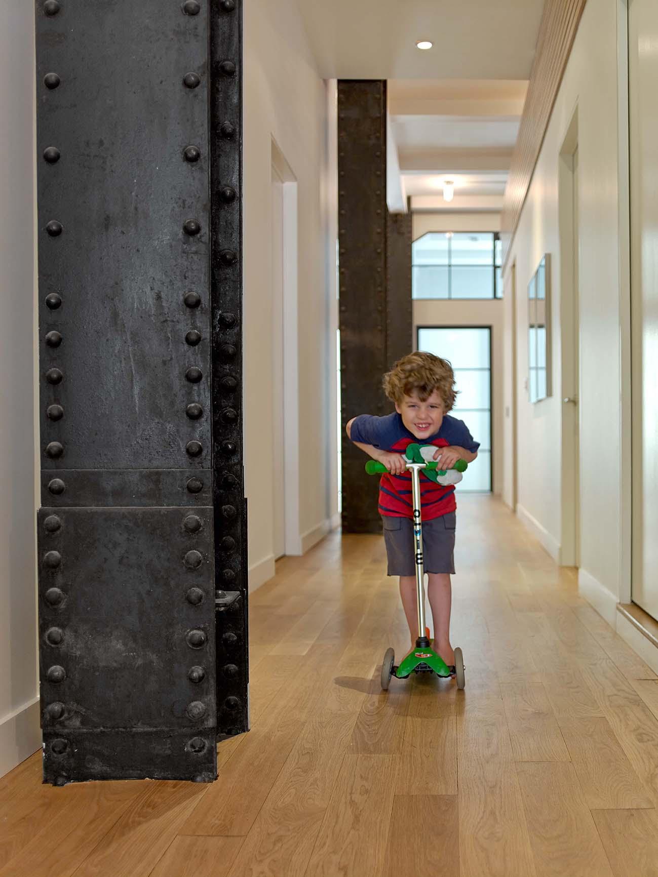Flat Iron Loft Child on Scooter in Hallway