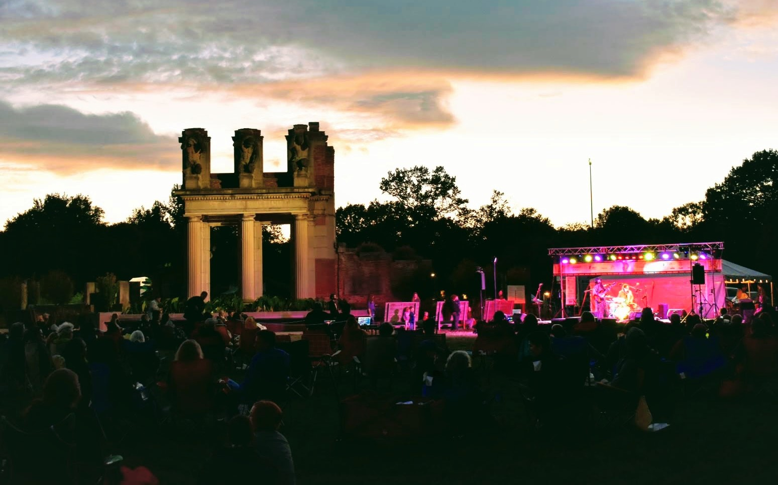 Photo of the ruins at night during a concert.
