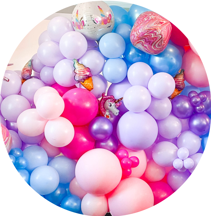 A cluster of pink, blue, and purple balloons