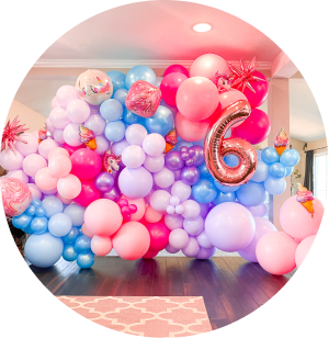 A blue, pink, and purple balloon wall