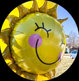 A yellow sunshine mylar balloon