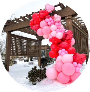 A pink and red balloon garland