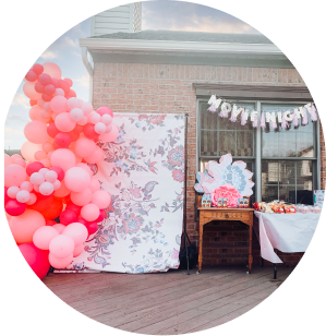 A pink and red backdrop balloon garland