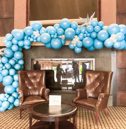 A blue balloon garland