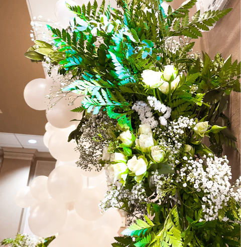 Florals in front of white balloons