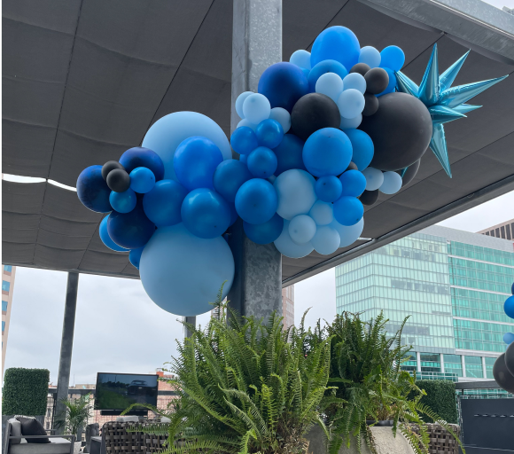 A blue and black balloon garland