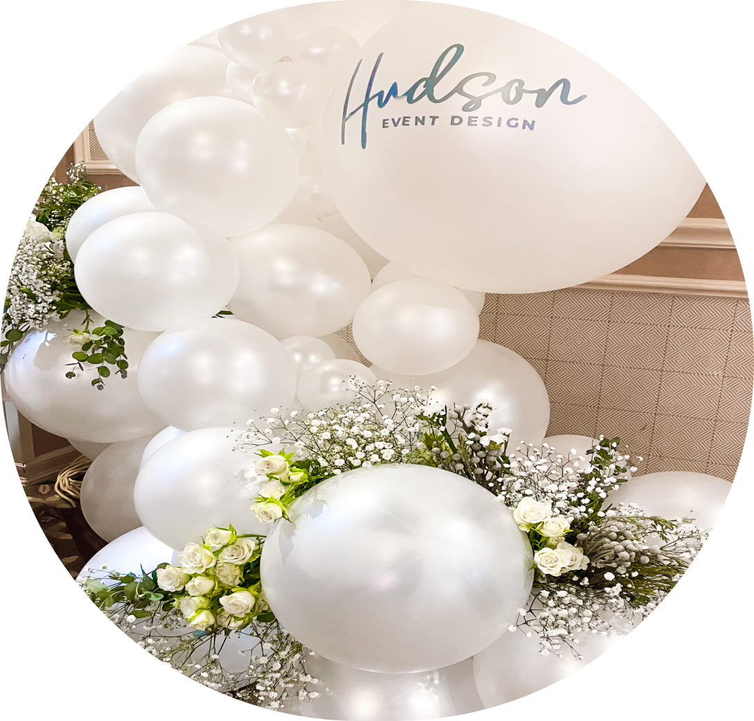A cluster of white balloons