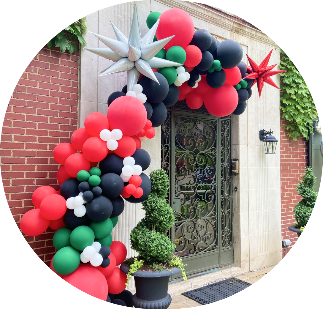 A red, black, white, and green balloon garland