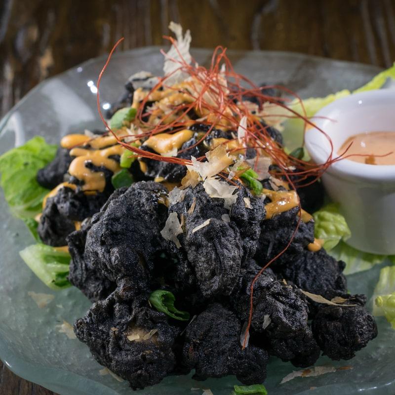 MIKHUNA's Volcano Rock Shrimp. Fried Shrimp tempura with squid ink for a deep black color.