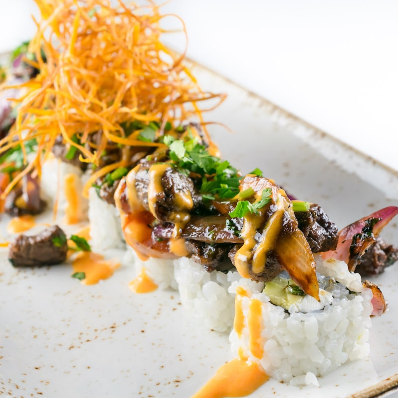 Our twist on a Peruvian classic, try Lomo Saltado as a Maki roll at MIKHUNA