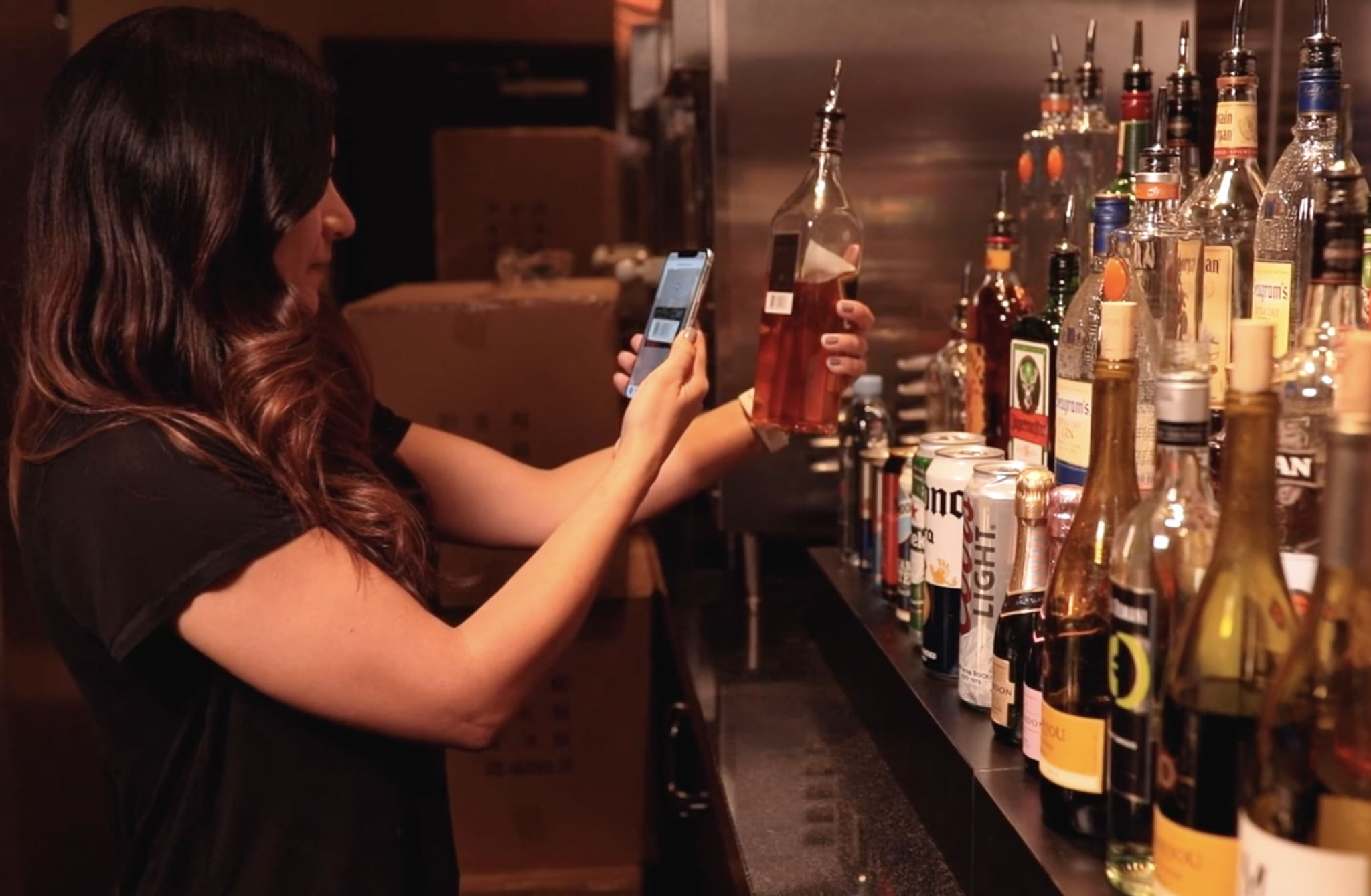 woman, alcohol, iphone, barcode scanner, bar and restaurant management software
