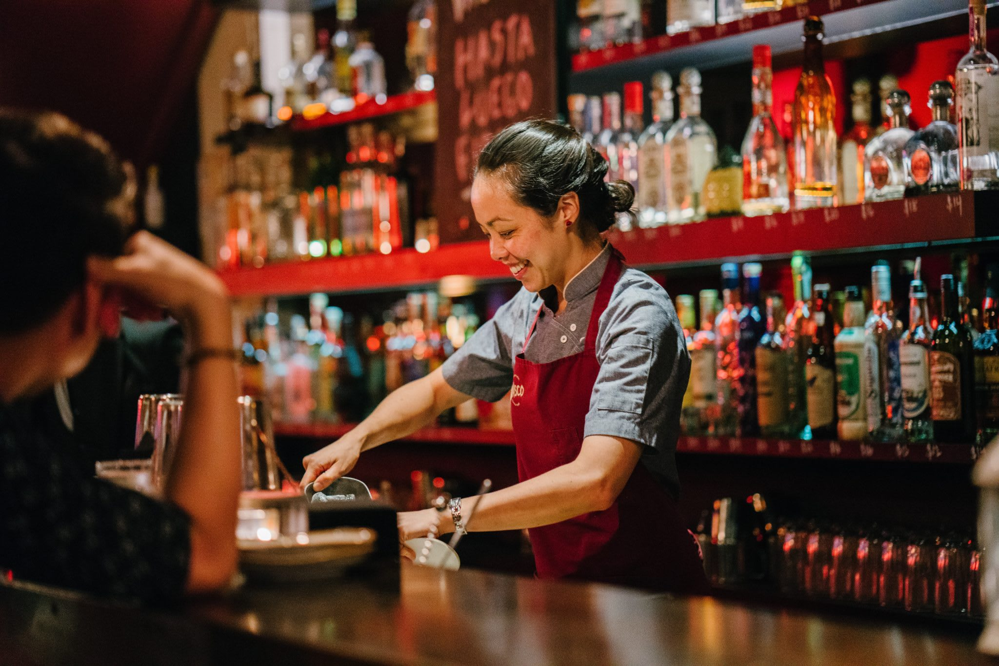 bar, bartender, woman, liquor bottles, bar inventory management