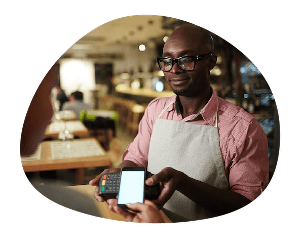 Image of a restaurant owner with a pos system that integrates with WISK