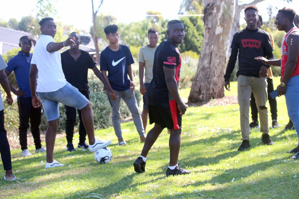 Guys playing soccer.