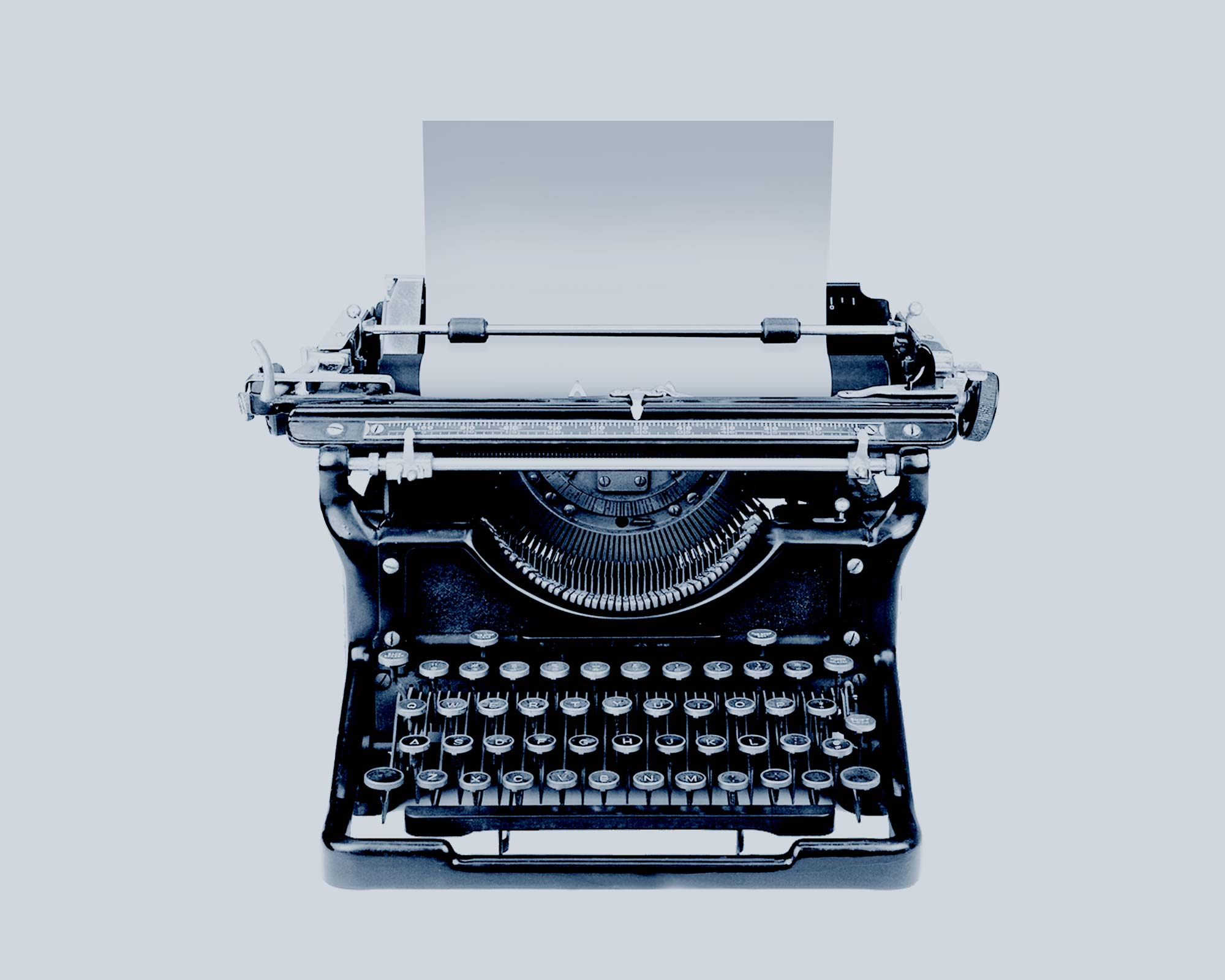 Image of an old fashioned black typewriter, loaded with paper.