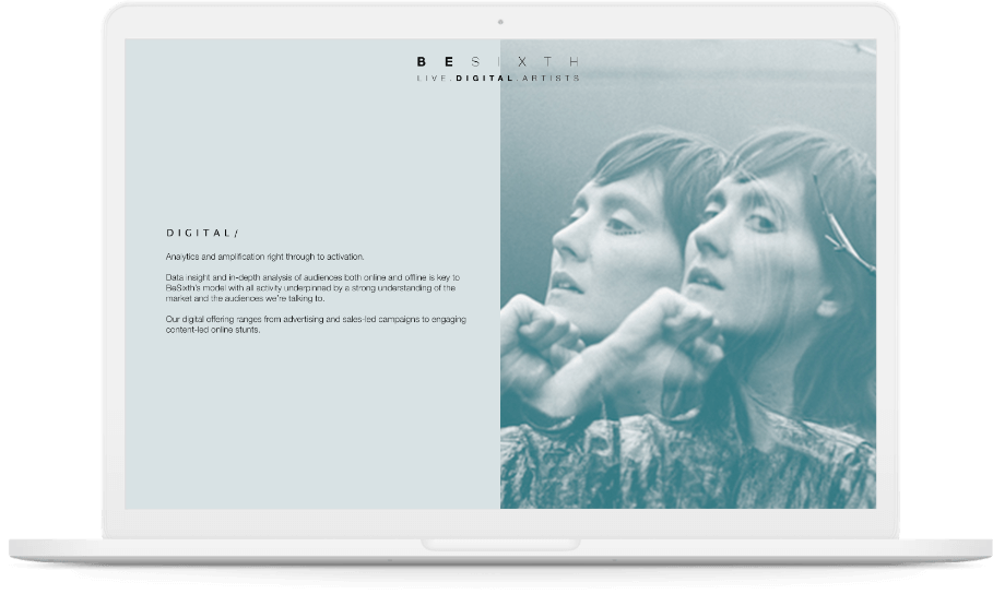 Besixth 'Artists' page displayed on white laptop.