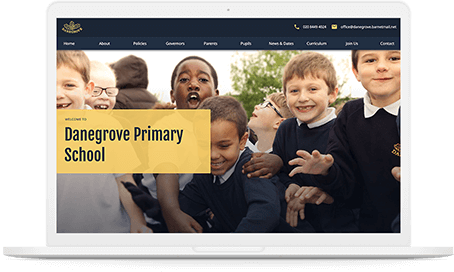 Danegrove primary school website Homepage displayed on a white mac-book pro.