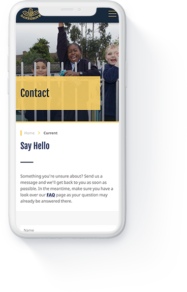 Danegrove primary school website 'Contact' page displayed on a white iPhone.