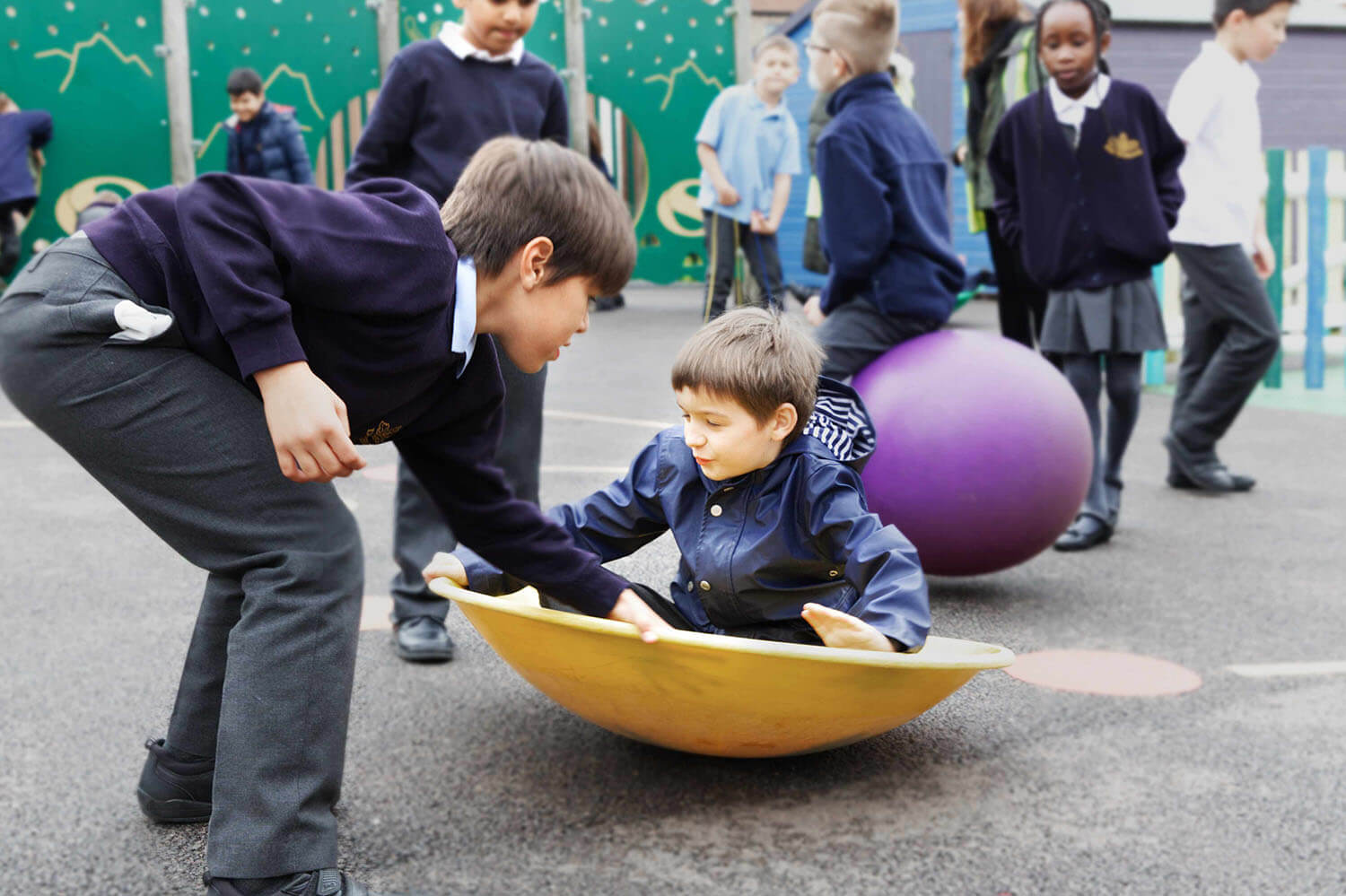 School boys in primary school playing in the playground