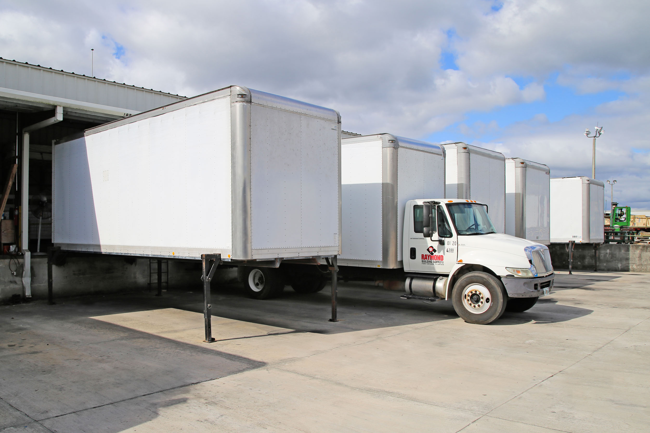 Swap Body containers at a warehouse loading dock.