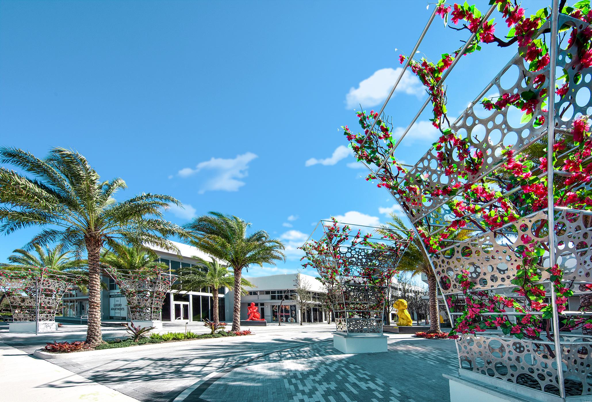 sanctuary entrance palms and blue sky