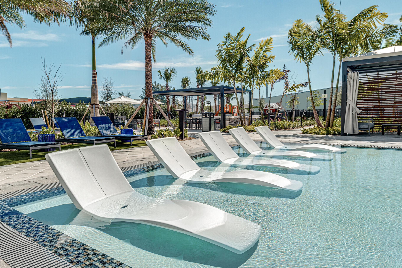 Pool Lounge chairs cabana and palm trees
