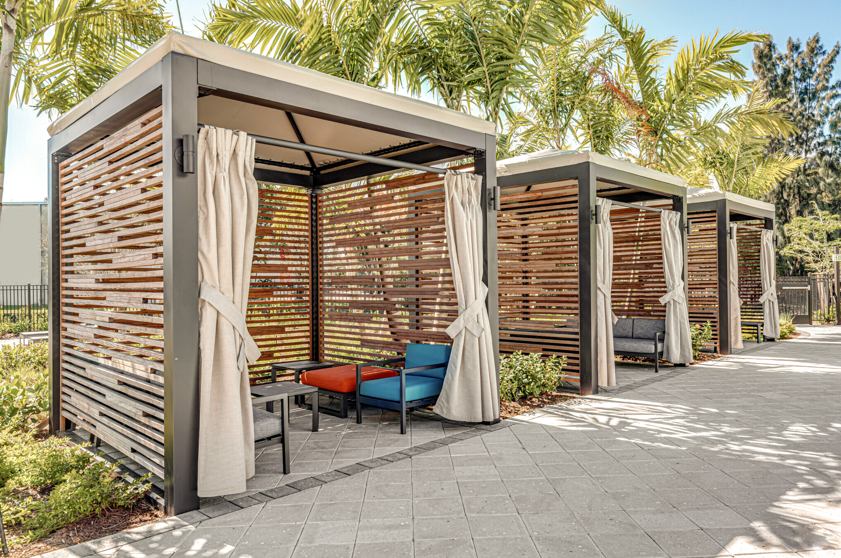 Three Cabanas with palm trees behind