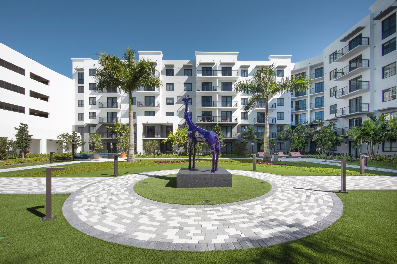Purple Giraffe Sculpture Sanctuary garden and courtyard