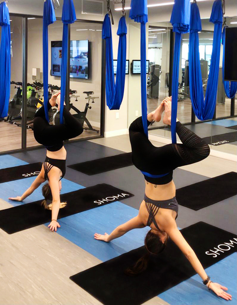 Two women doing aero yoga